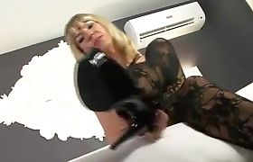 Stunning transsexual Lora playing on the bed